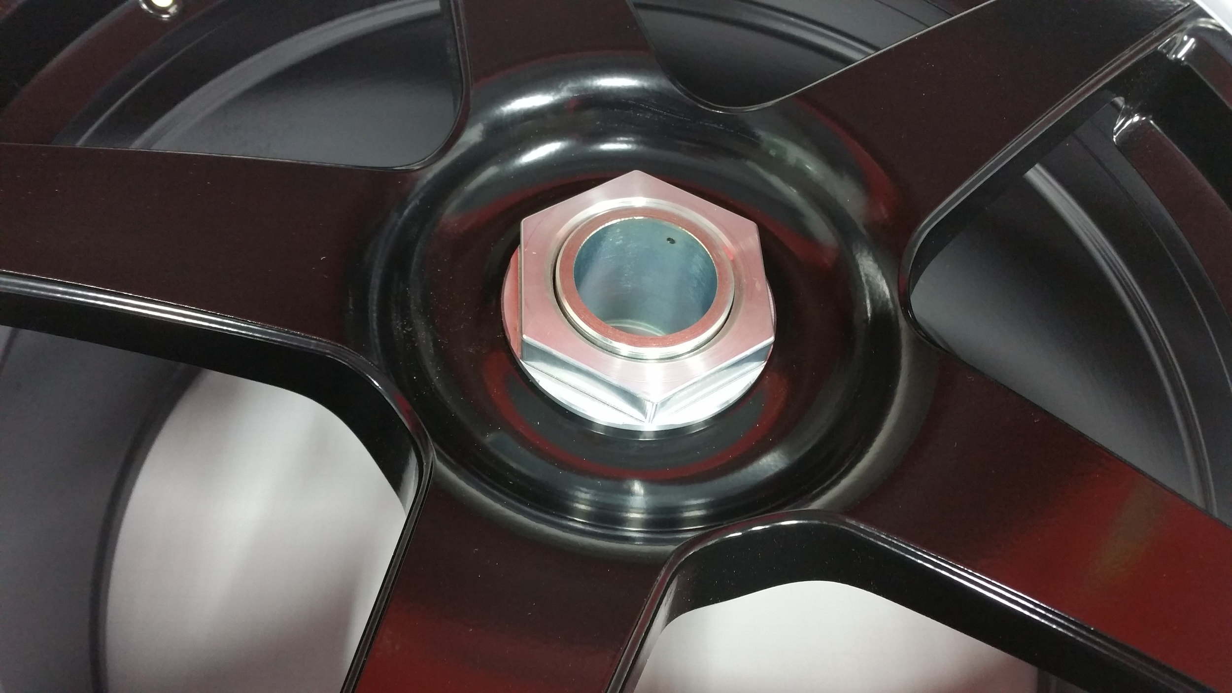 Closeup of a Forgestar CF5 wheel converted to centerlock.
