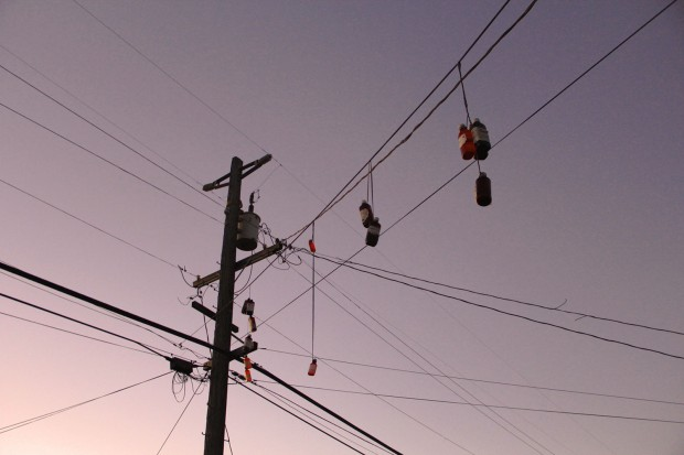 Bottles of cough syrup hang from power lines in Central Richmond. They are both a signal that hits of codeine can be found here and also a testament to the growing presence of abused prescription drugs on the streets of Richmond. PHOTO:Julie Brown