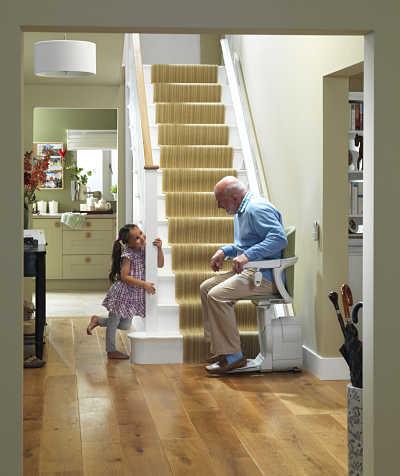 man-with-child-at-bottom-of-stairs-on-stair-lift_opt.jpg