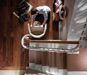 professional-technician-installing-curved-stair-lift_opt.jpg