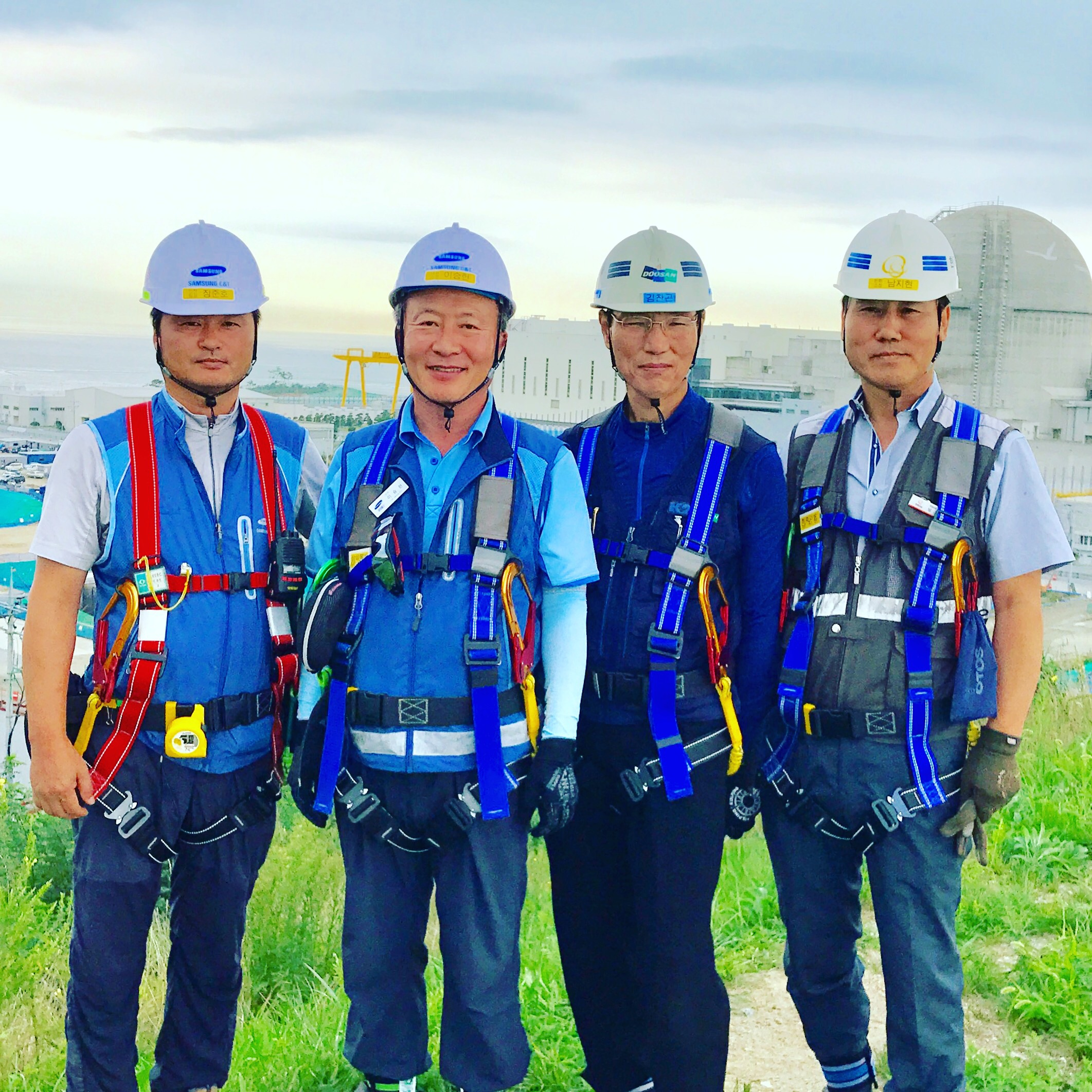 South Korea's top nuclear construction managers in front of Shin-Kori Reactors 3 and 4. Construction on Shin Kori-5 and Shin Kori-6 has been temporarily halted.