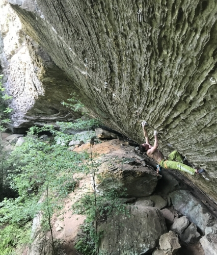 Dru Mack climbing Zookeeper (14a) in the Red River Gorge