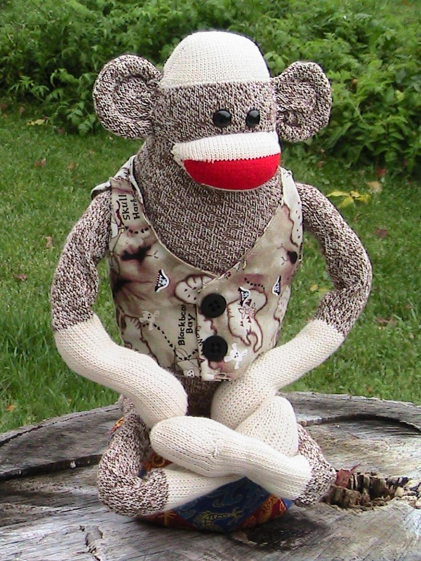 Sock puppet monkey practicing breathing.