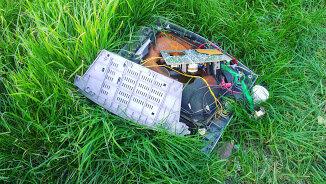 Copy machine waste in a field.