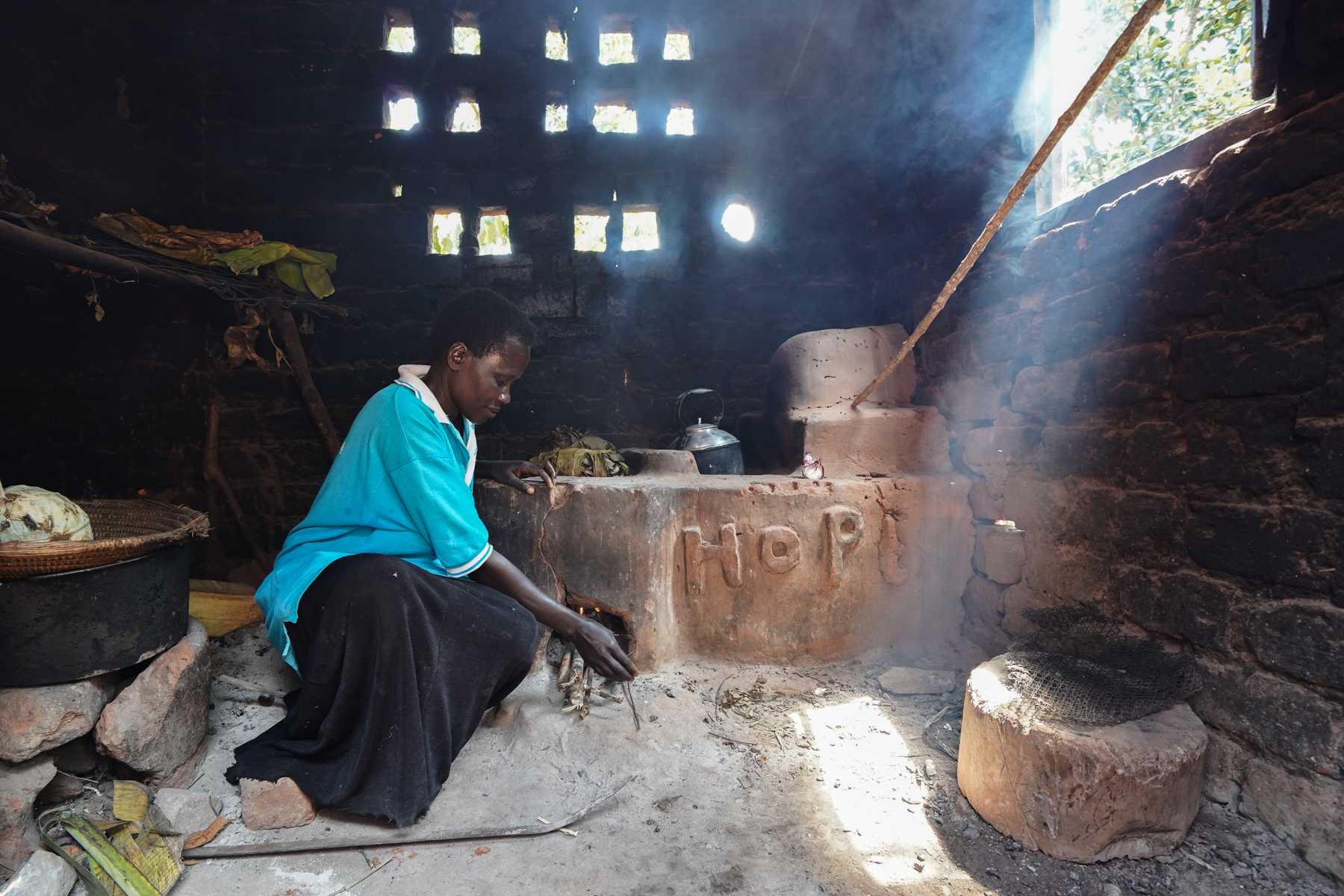 An example of the energy-efficient cookstove being built by women in the HoPE-LVB project. While traditional cookstoves make cooking areas quite smoky, this cookstove has a chimney that filters smoke outside. With more insulation for the fire, it also conserves firewood use.