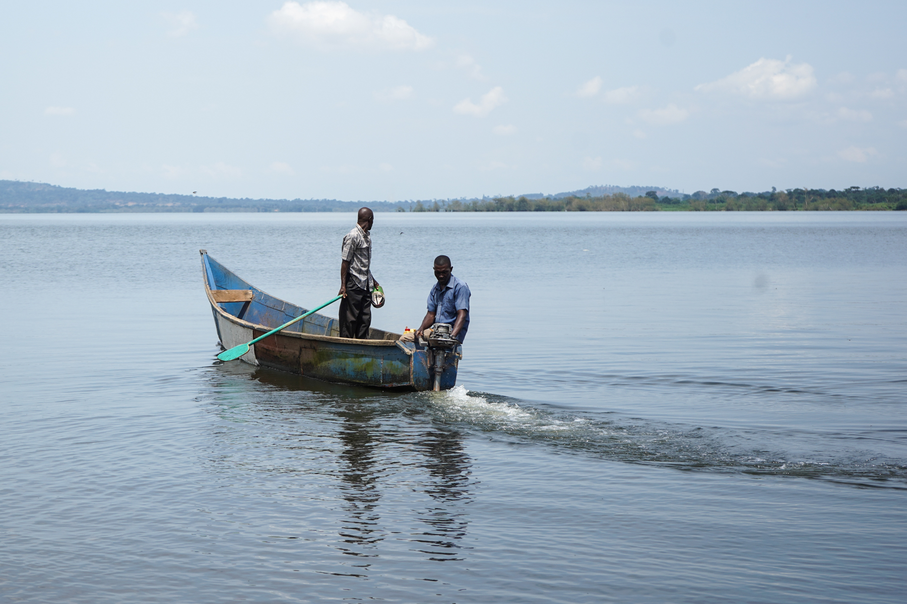 One of the wooden boats typically used on Lake Victoria. This one has a motor — most don't