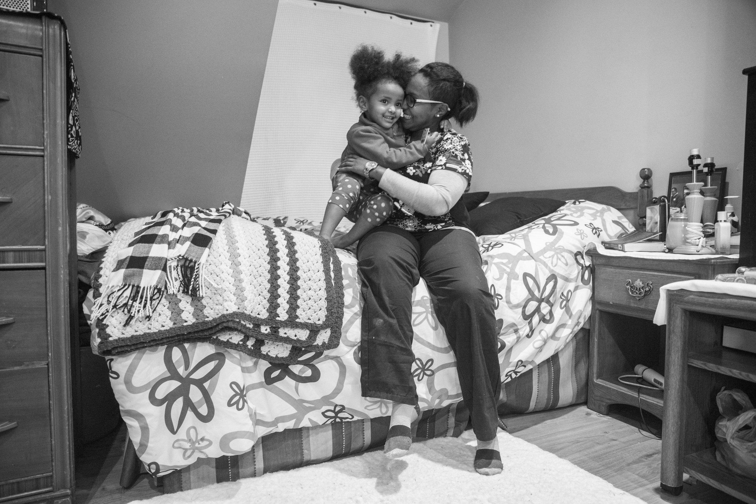 Dunia Hirsi embraces her daughter, Maya.