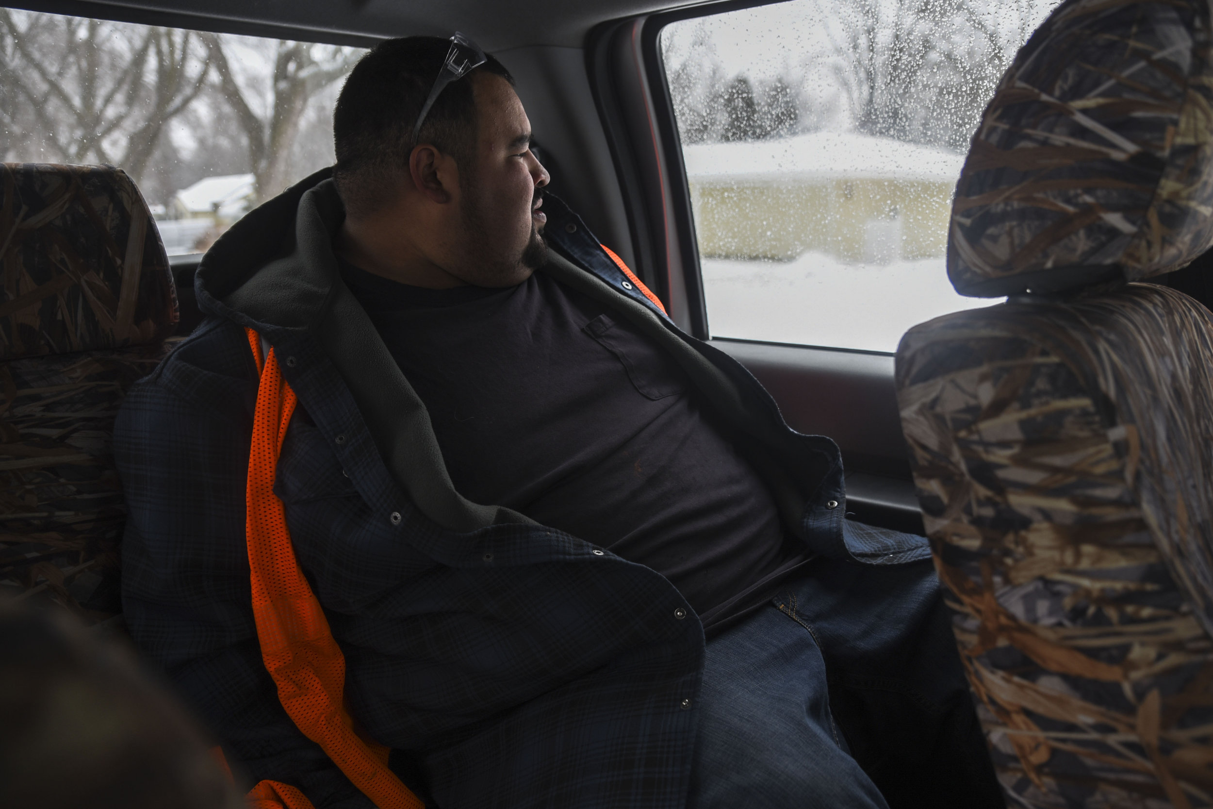 Martin Bravo, who has been in jail since early January and plans to leave in April, looks out the window while riding in the recycling pickup truck. Bravo is a part of the Sentencing to Service program, which will give him the opportunity to be released early from jail, dependent upon his eligibility, by volunteering with the recycling program through Kandiyohi County Community Service.