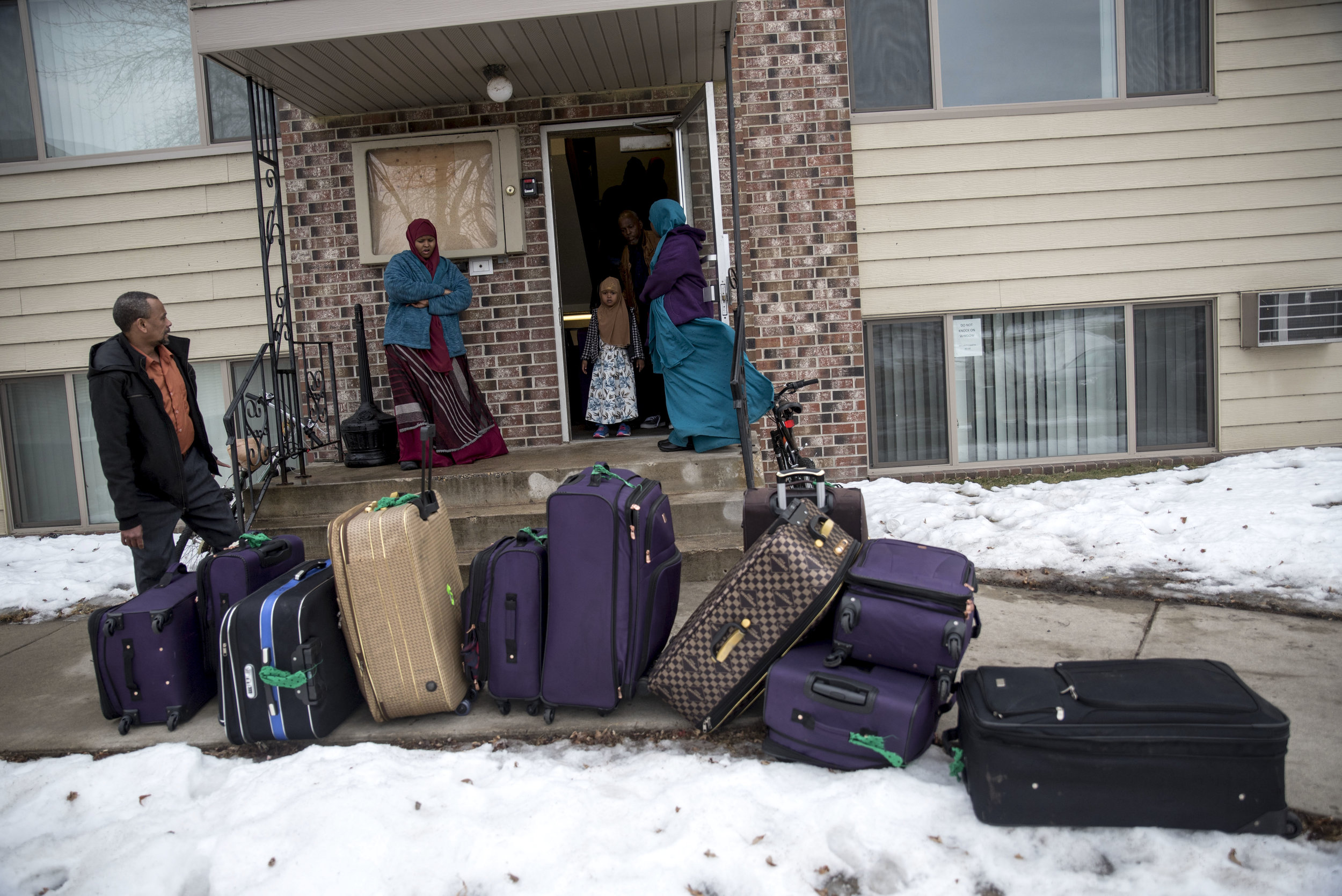 Kosar and her family members carry suitcases out of their apartment in Willmar to leave for the Minneapolis-Saint Paul International Airport Mar. 4. Eight of Kosar's siblings and her two parents are flying back to stay in Garissa, a city in Kenya, for several years while she and her sister Ismahan Kosar stay in Willmar. The Kosar's traveled back to Kenya to allow the children to familiarize themselves with the family's culture.