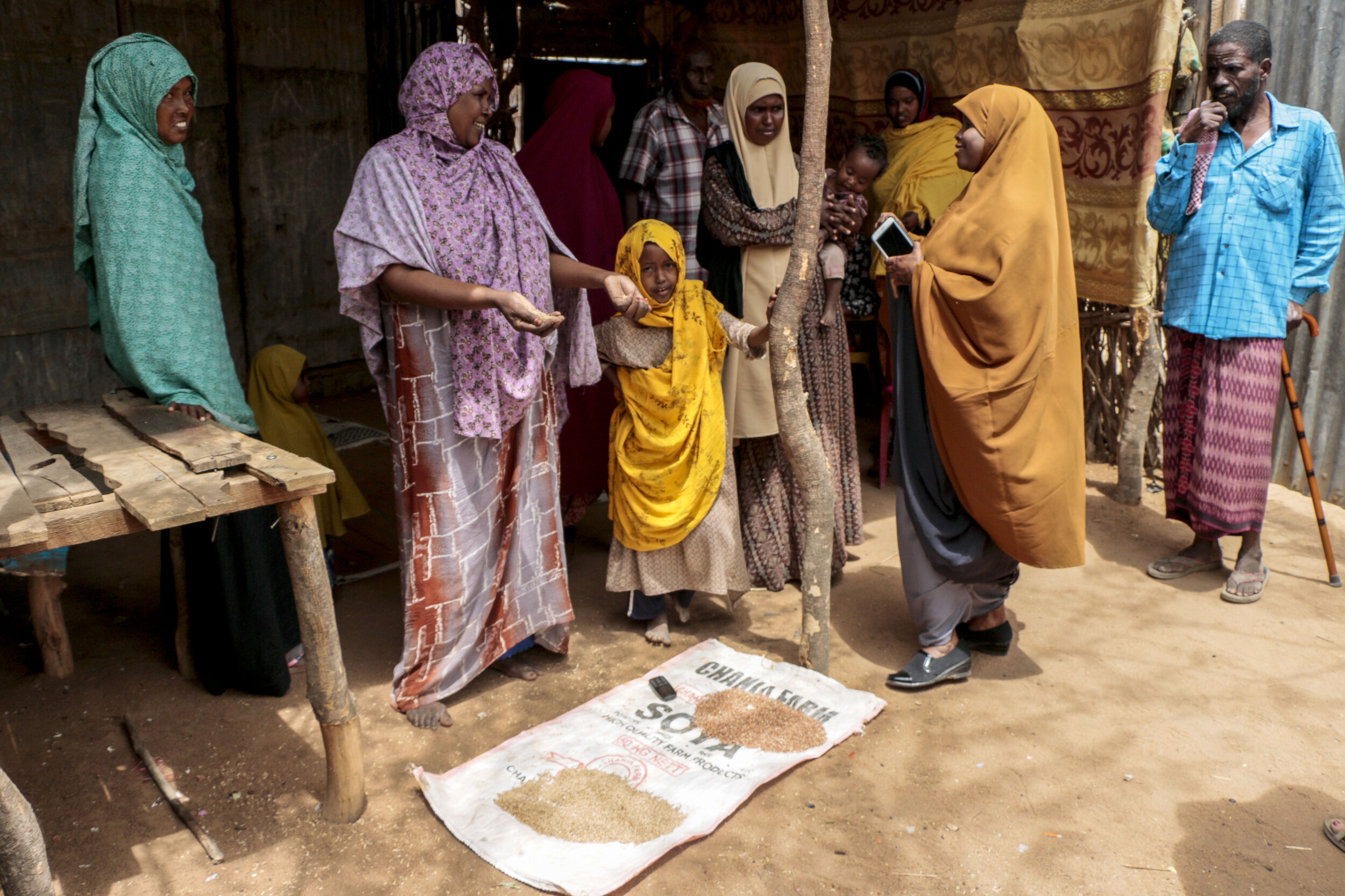 Hamdi Kosar speaks with Ruqia Osman and her family in her home Aug. 19 at the Dagahaley Refugee Camp in Dadaab, Kenya. Osman speaks about the food provided for the refugees at the camp, pictured below, and how the camp has changed over the past several years.