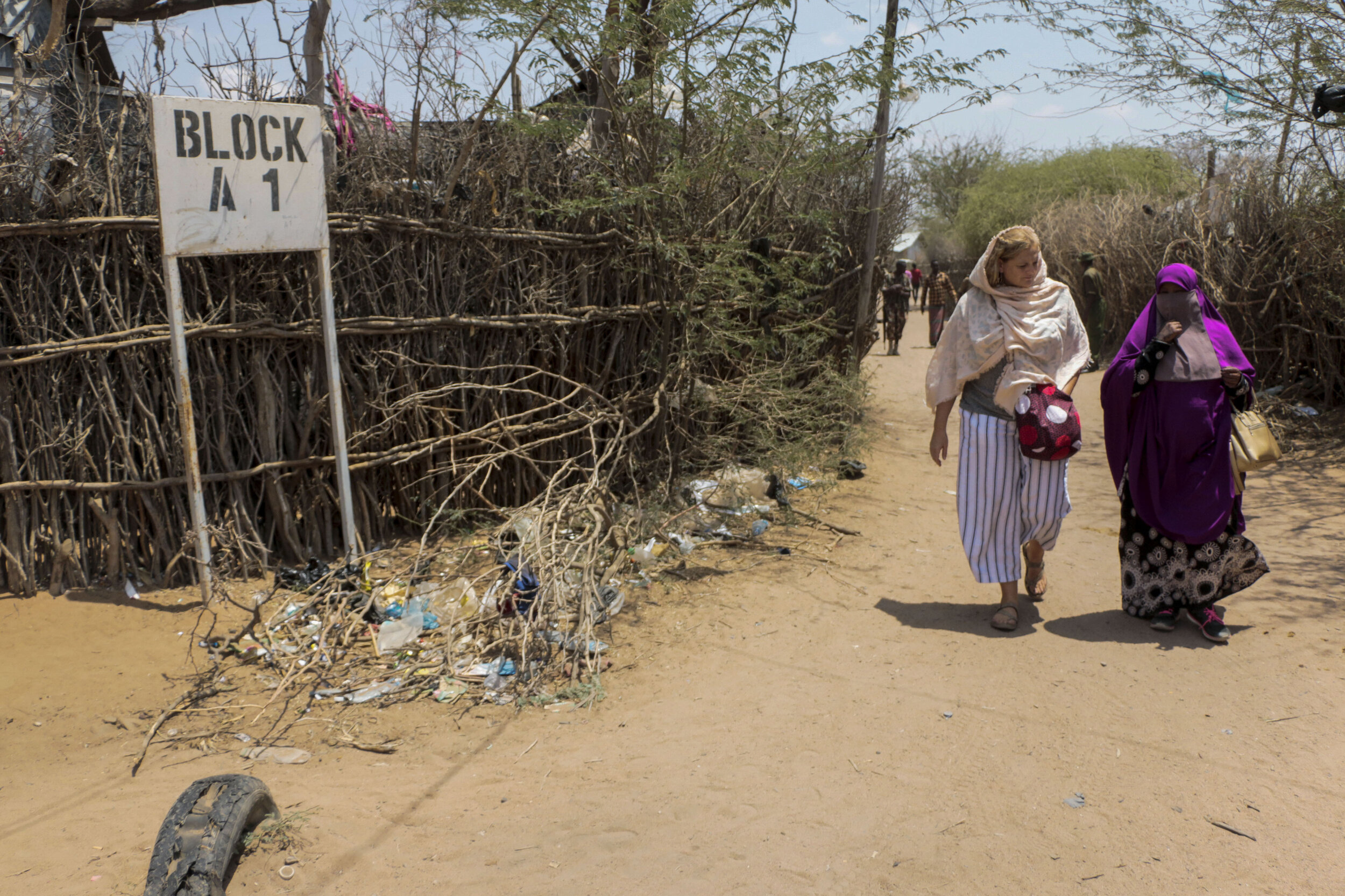 Jessica Rohloff, left, and Hamdi Kosar walk through the A1 Block Aug. 19 where Kosar was born at the Dagahaley Refugee Camp in Dadaab, Kenya. The pair visited Kosar's former home that now houses a new family.