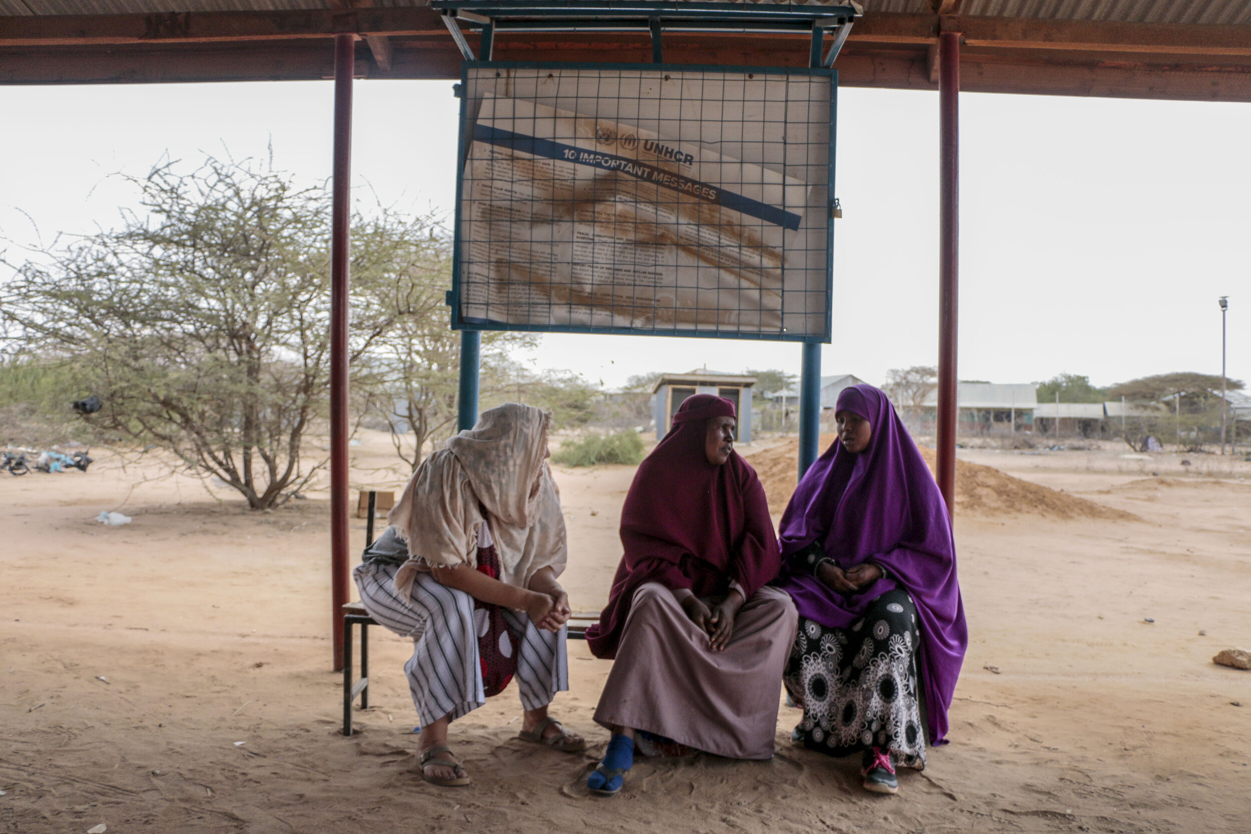 Jessica Rohloff, left, Ruqia Osman and Hamdi Kosar sit in the Dagahaley Transit Centre where many refugees wait to be interviewed for the resettlement process Aug. 9 at the Dagahaley Refugee Camp in Dadaab, Kenya. Osman, a Somali refugee and current resident, has been in the camp for around 30 years and went through the resettlement process with Kosar's family nearly a decade ago.