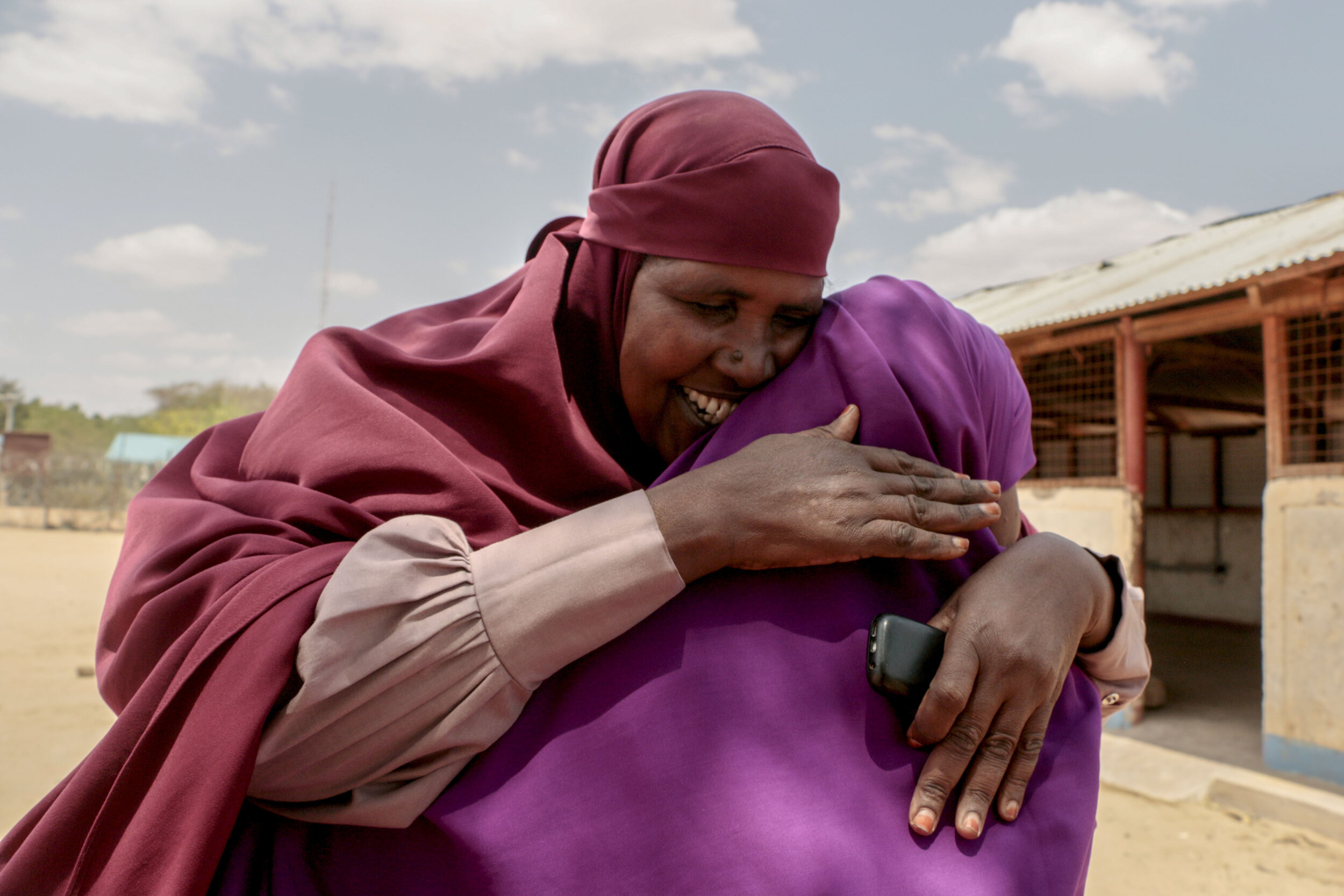 """Ruqia Osman embraces Hamdi Kosar Aug. 19 at the Dagahaley Refugee Camp in Dadaab, Kenya. Osman has lived in the camp for around 30 years and went through the resettlement process with Kosar's family nearly a decade ago. Her daughter, who she hasn't seen in 10 years, was resettled to the U.S. and now lives in Willmar. """"I talk to myself because I miss her so much,"""" Osman said to Kosar. """"Seeing you I am able to see my daughter."""""""