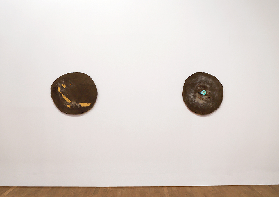 'Slice III' and 'Slice I', 2015. Aluminous cement, metal powder (brass and copper).