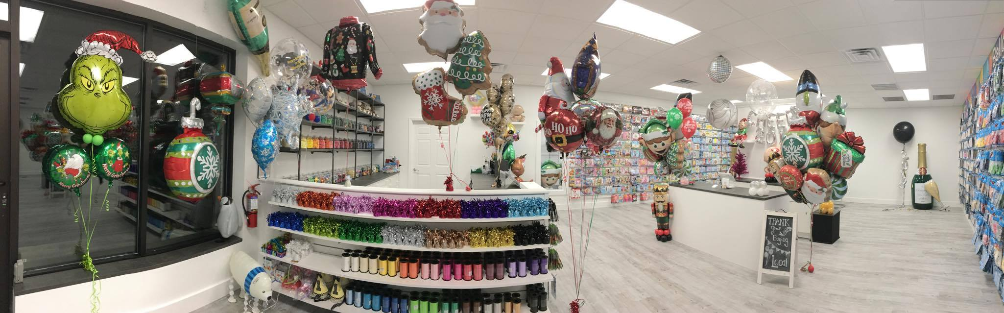 Peek into our Retail Balloon Shop - Can you find the Elf looking thru the workshop window?