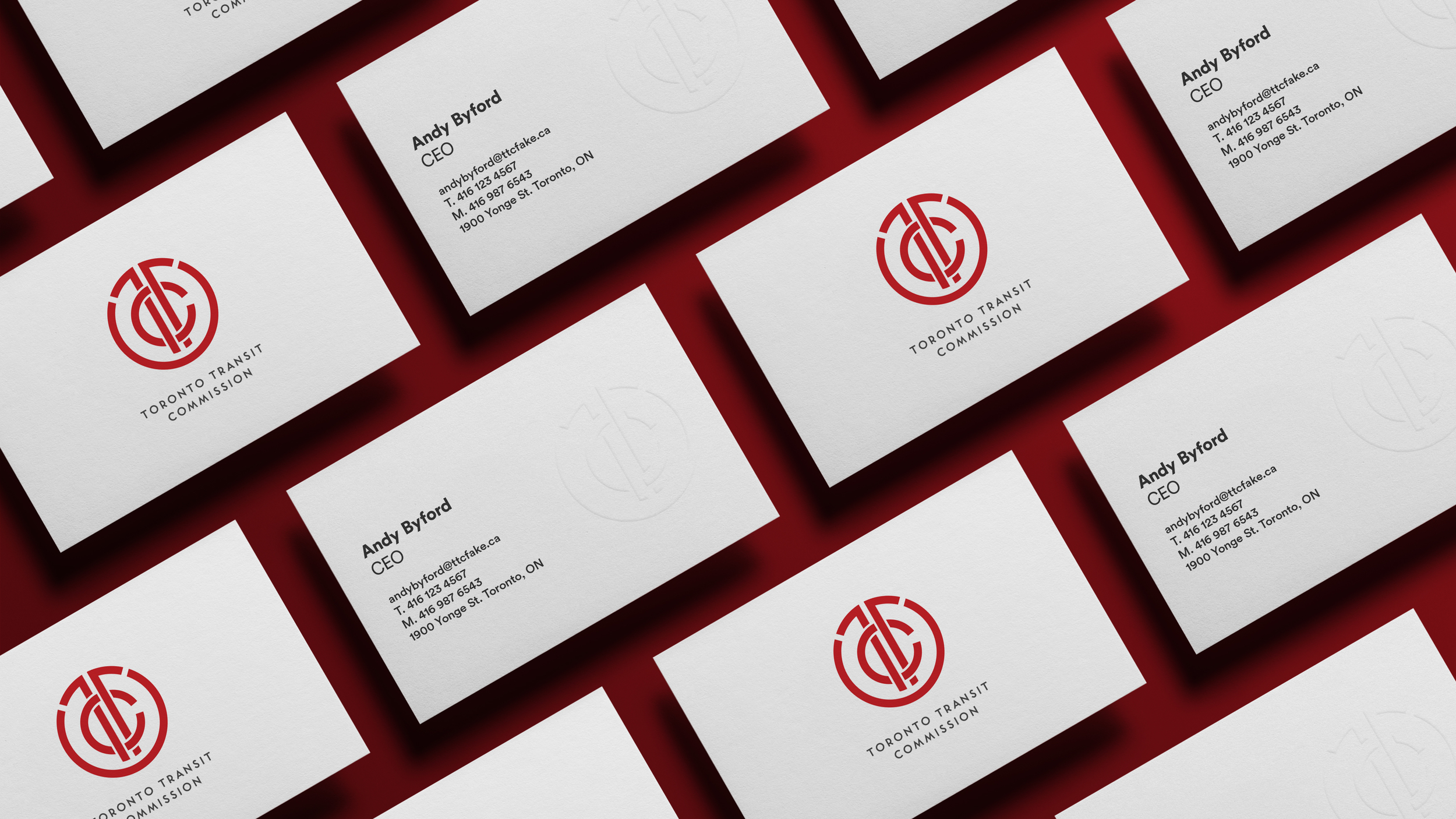 The business cards echo the simplicity of the logo design, with embossing visible on the back and the logo on the front.