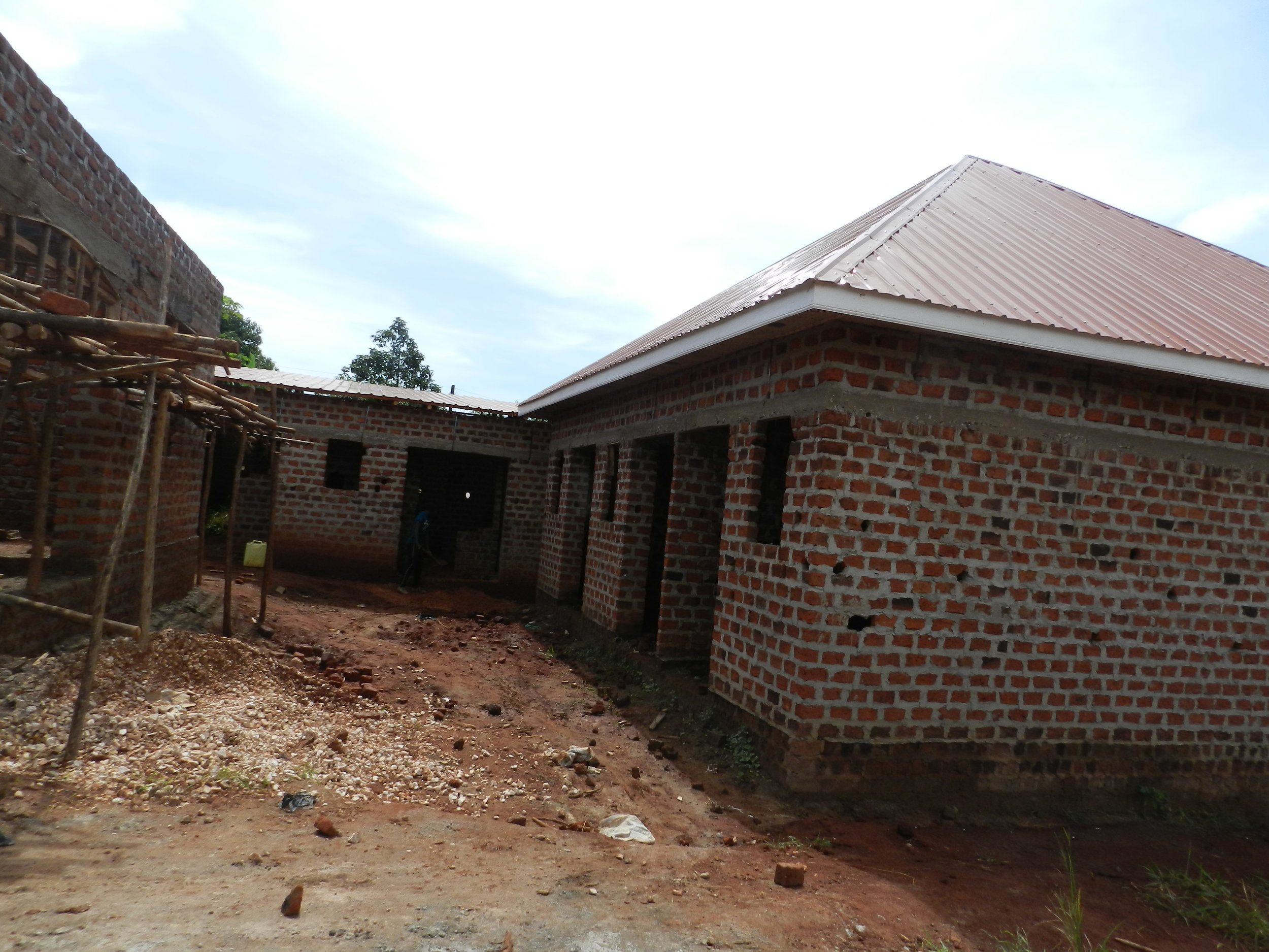 May, 2019. The two housing complexes have been roofed and the training facility has its foundation and walls constructed.