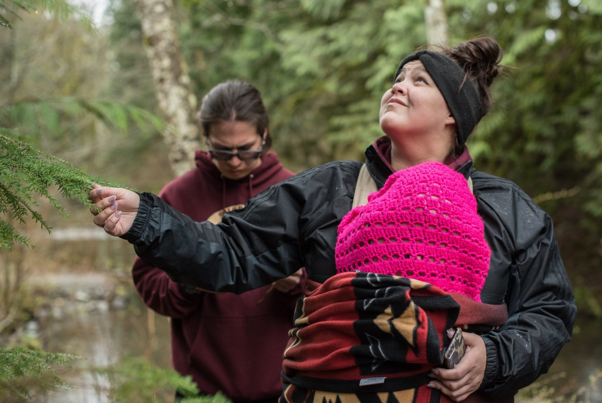 Char George looks at a tree after learning its traditional name during a class field trip to the traditional longhouse at Chiyák'mesh stakw, a piece of land on the bank of the Cheakamus River, just north of Squamish, B.C. (Dustin Patar)