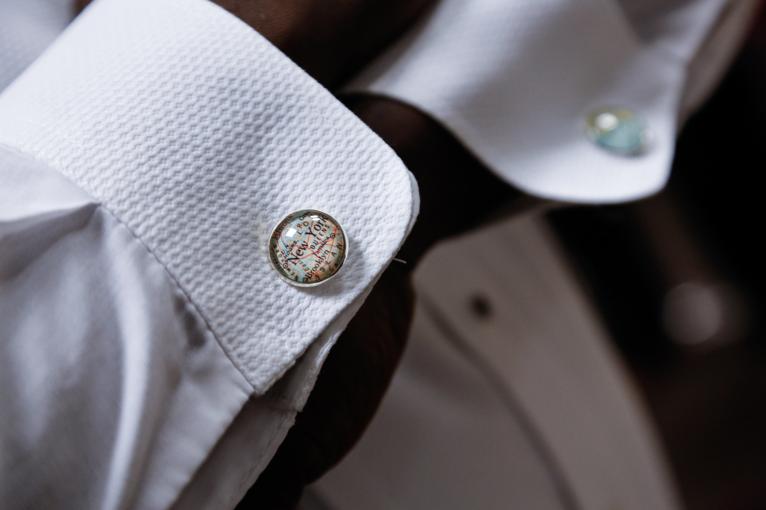 Groomsmen received custom cufflinks with the city they live in and the location their familes descended from. Antoine wore New york and Barbados at the wedding.