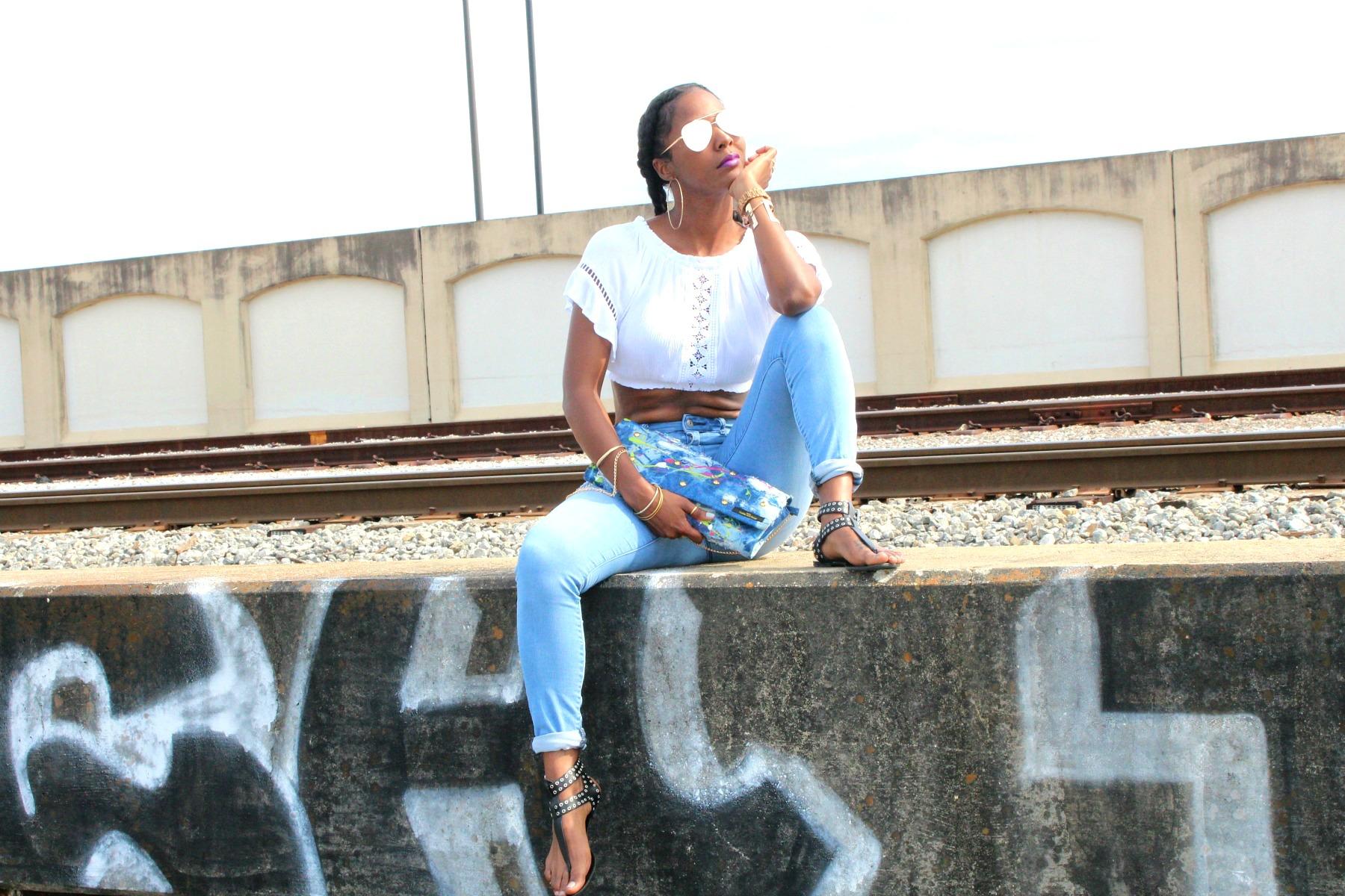 Denim graffiti clutch purse