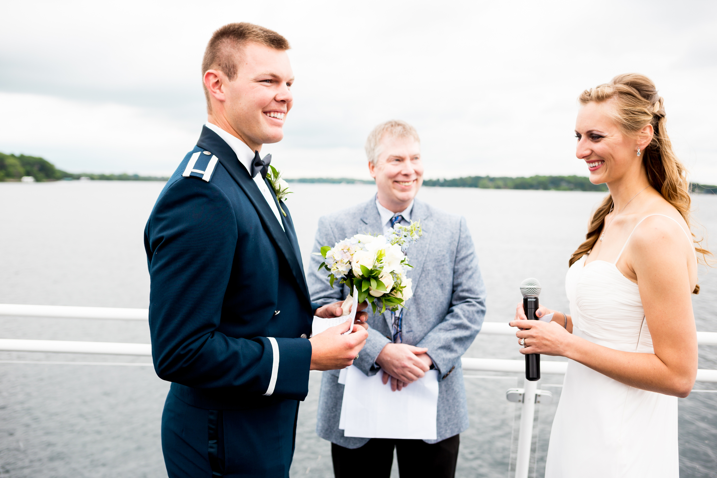 I don't think Jesse had planned on holding his bride's bouquet for her that day, but I guess he didn't mind too much!!