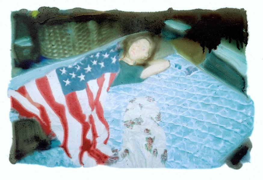 flagboyinbed.jpg