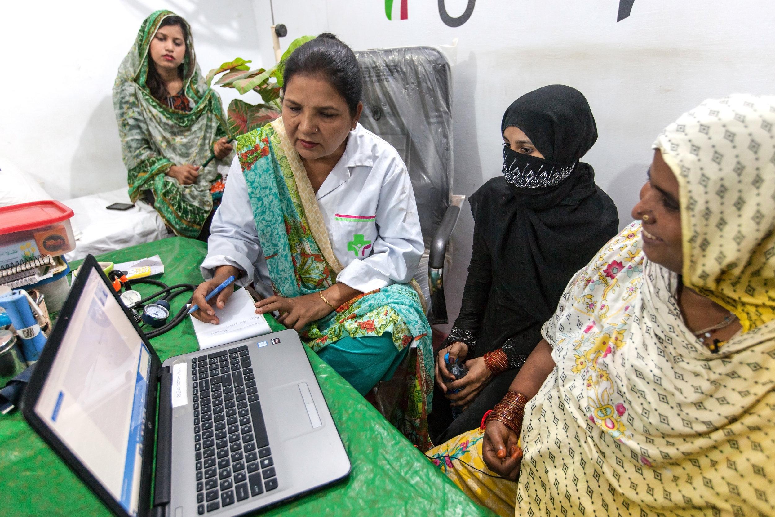 Episode2_KarachiPakistan_FemaleDoctorAndTwoPatientsInConsultation.jpg