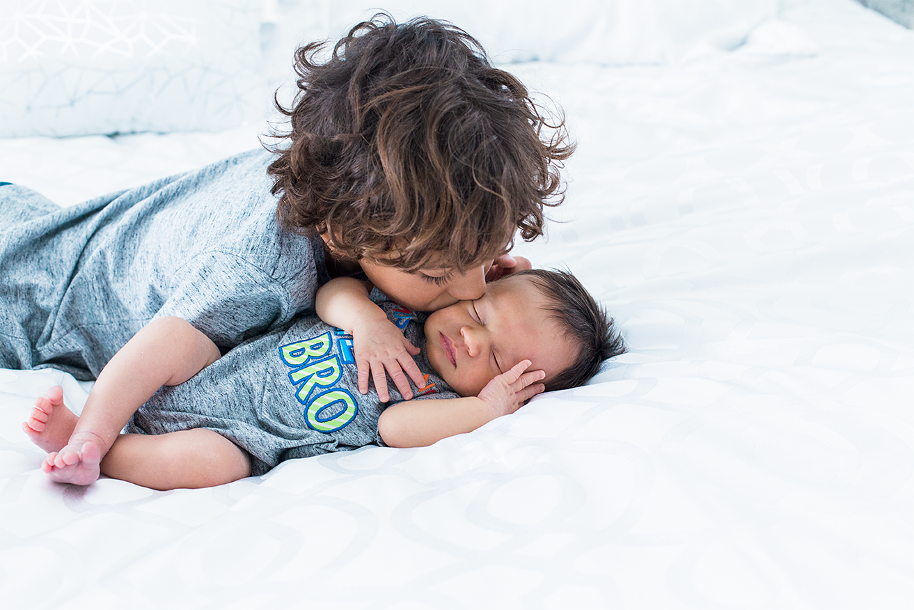 Big brother kissing his little brother