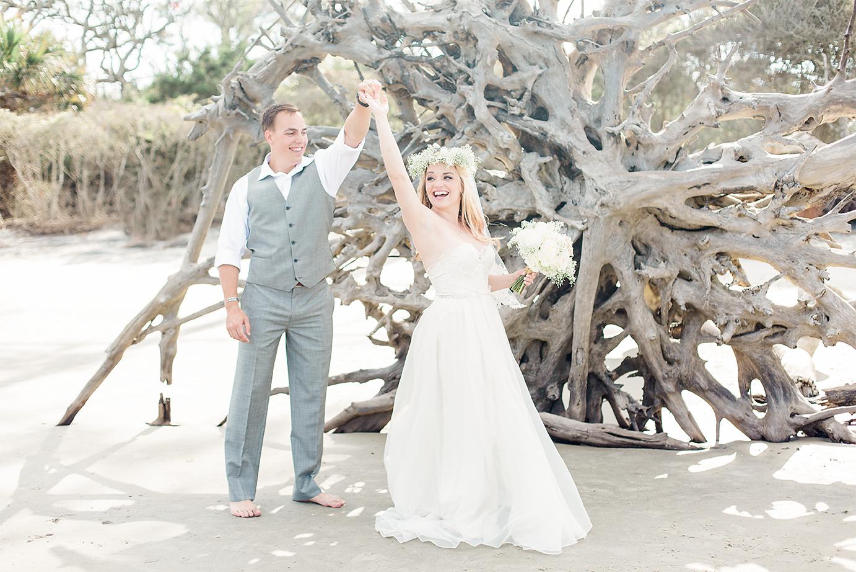 Bride and groom dancing in Driftwood Beach, Jekyll Island