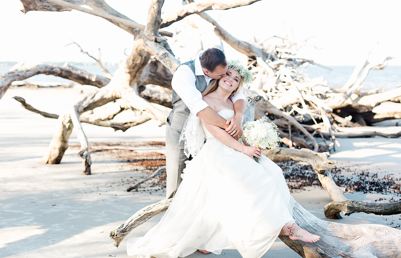 Bride and groom in Driftwood beach, Jekyll Island, GA