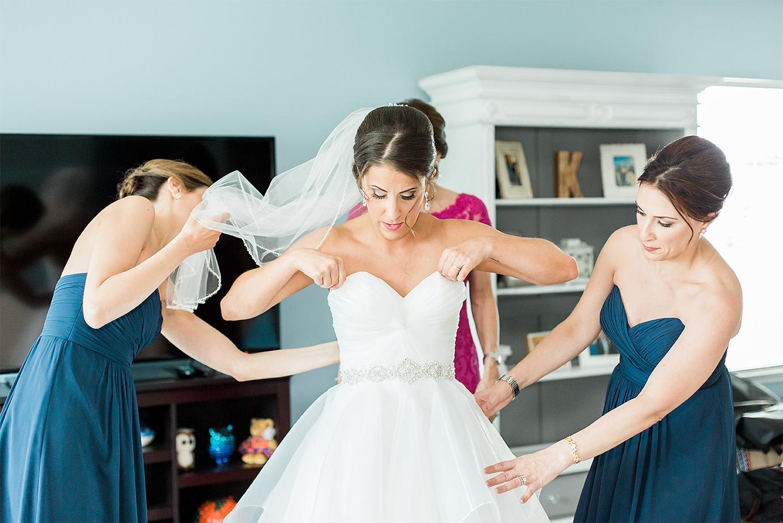 Bride getting her wedding dress on