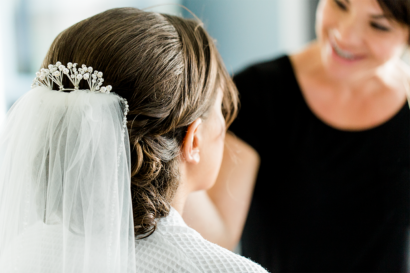 bride getting ready for her wedding   make up by sarina durdan