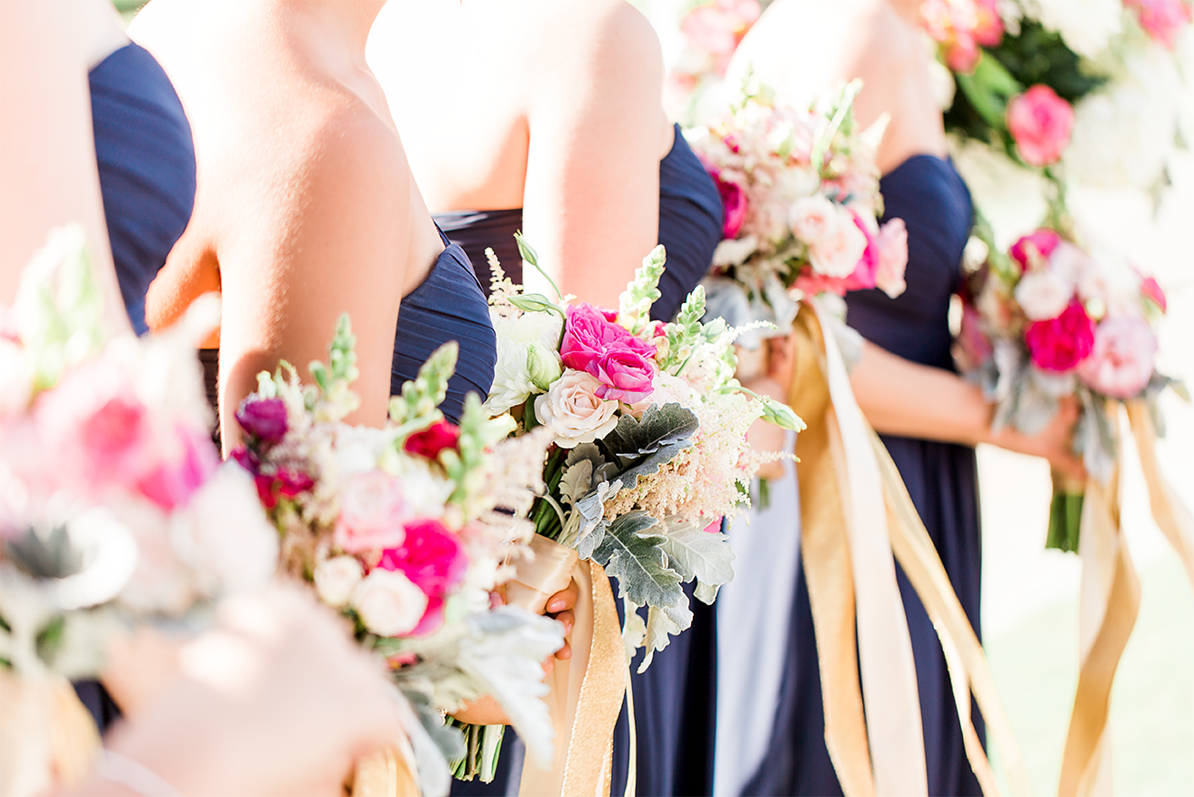 bridesmaids with their flower bouquets from happily ever after floral