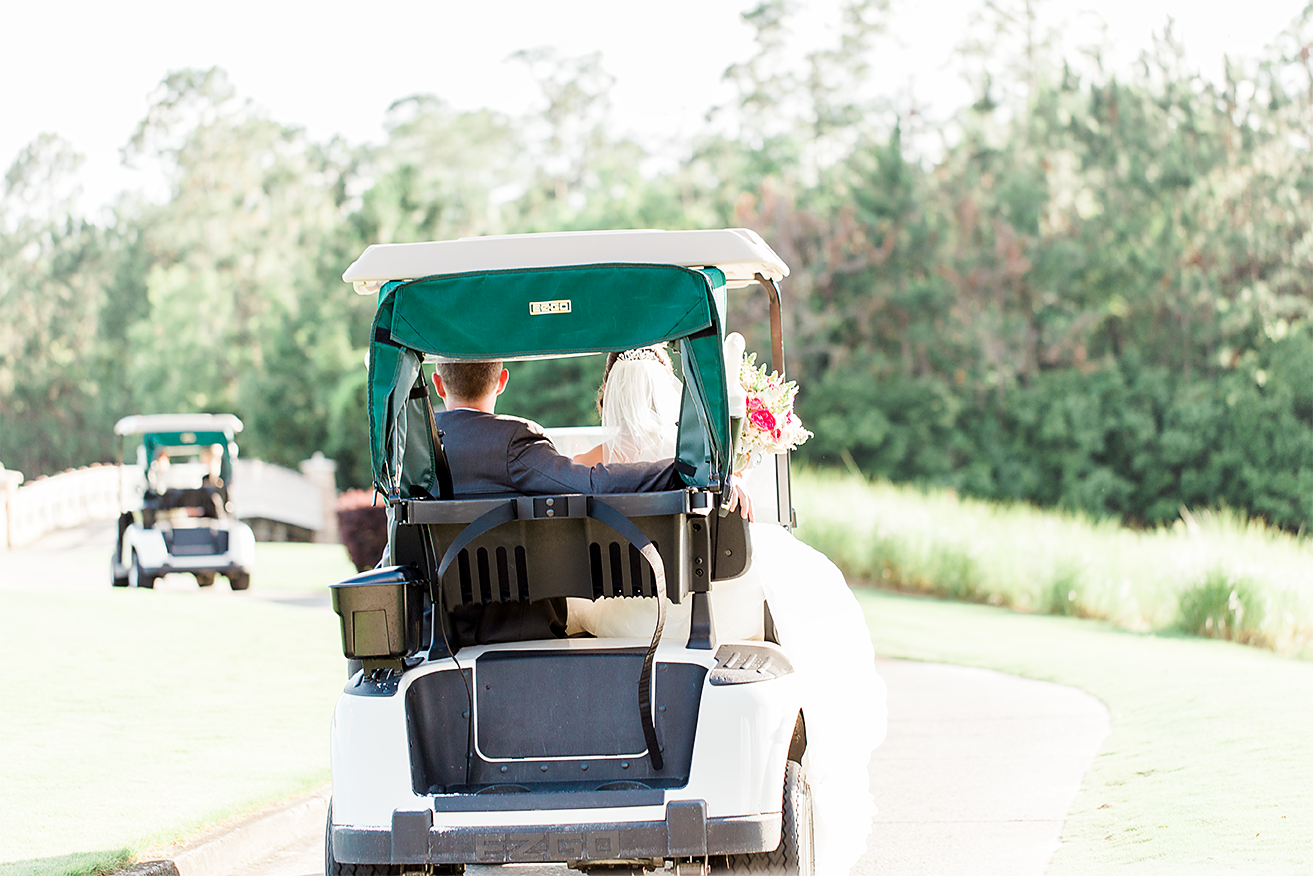 bride&groom driving a golf cart around in a golf course