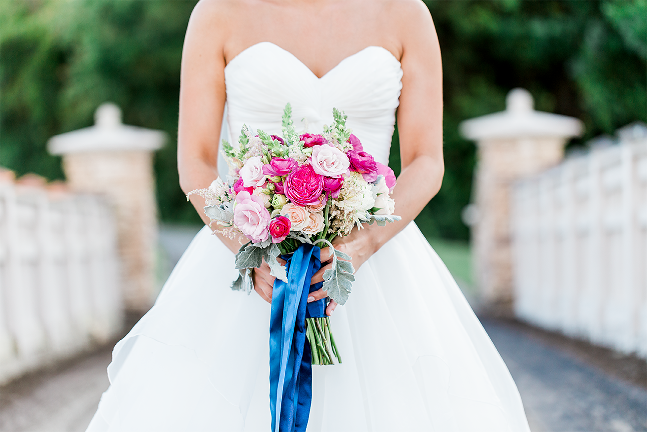 close up image of stunning bride in her Love Bridal Boutique wedding dress and wedding flower bouquet