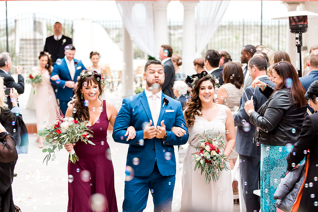 bridal party blowing the bubbles