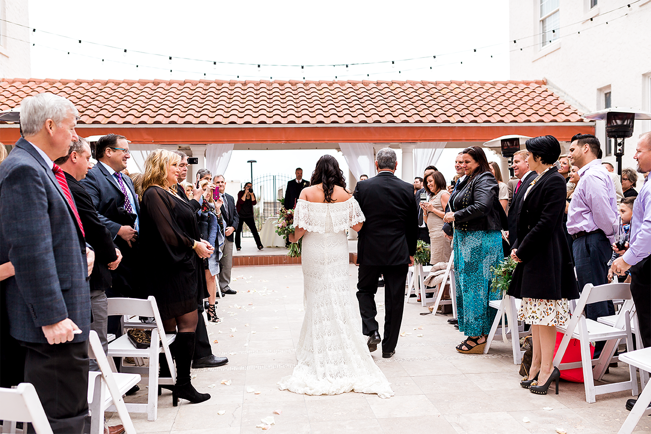bride walking down the isle with her dad in jacksonville beach wedding