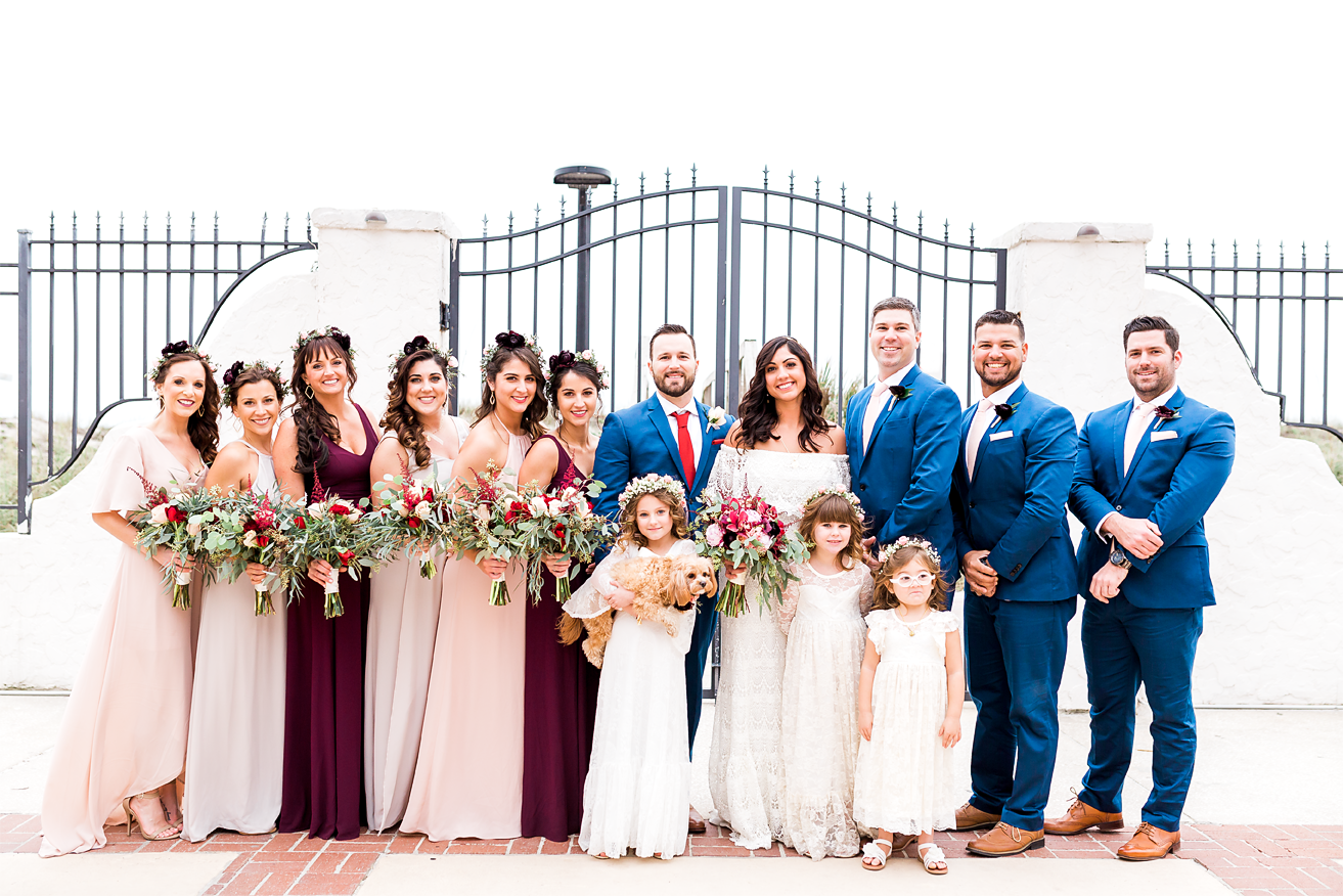 bride and groom with entire bridal party in jacksonville beach wedding