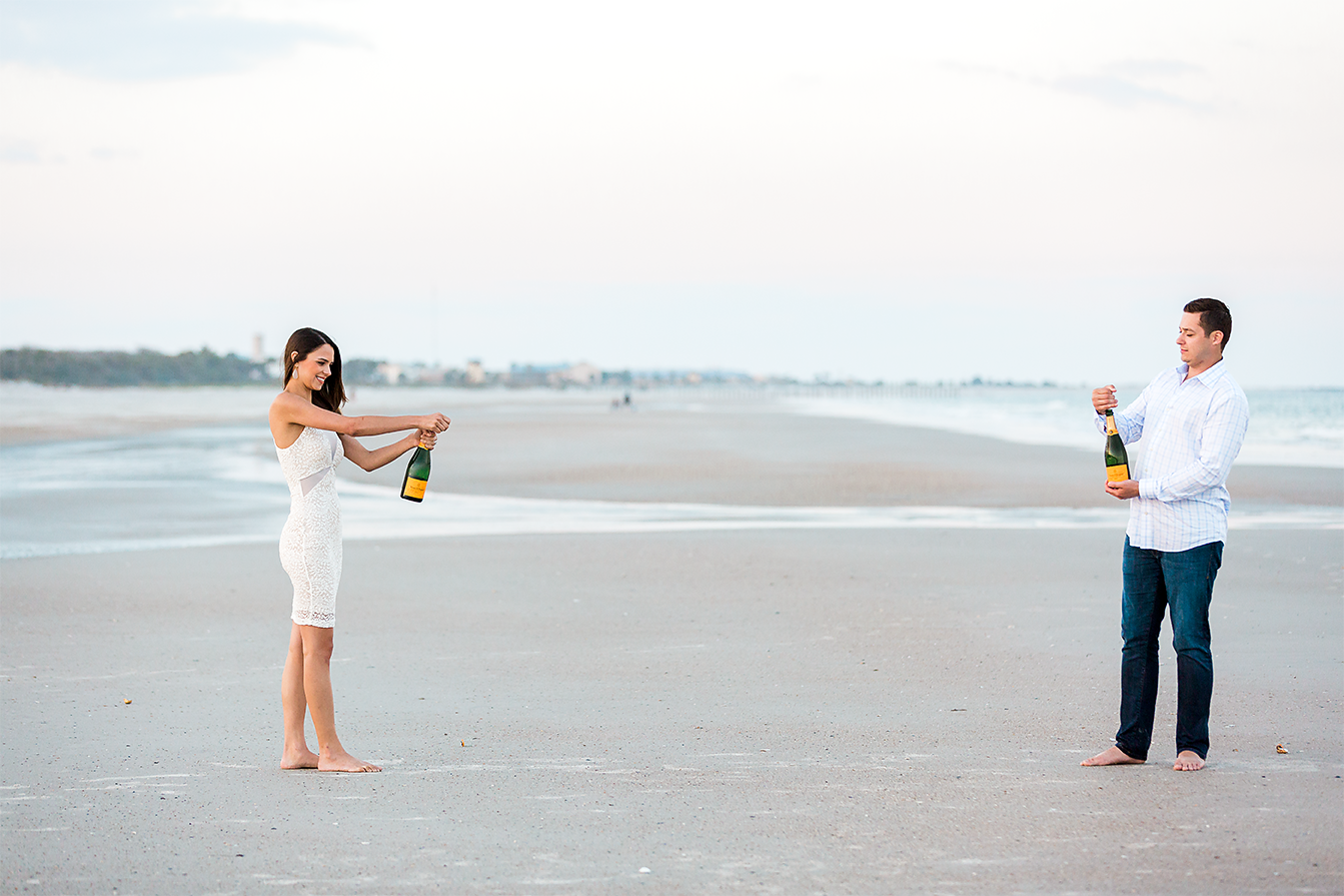 popping the bubbly during engagement pictures