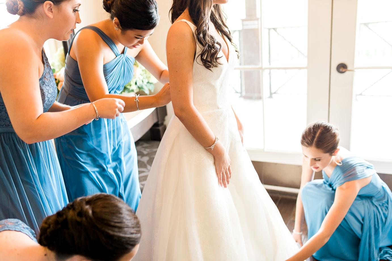 bride getting her weding dress on in Ponte Vedra, FL