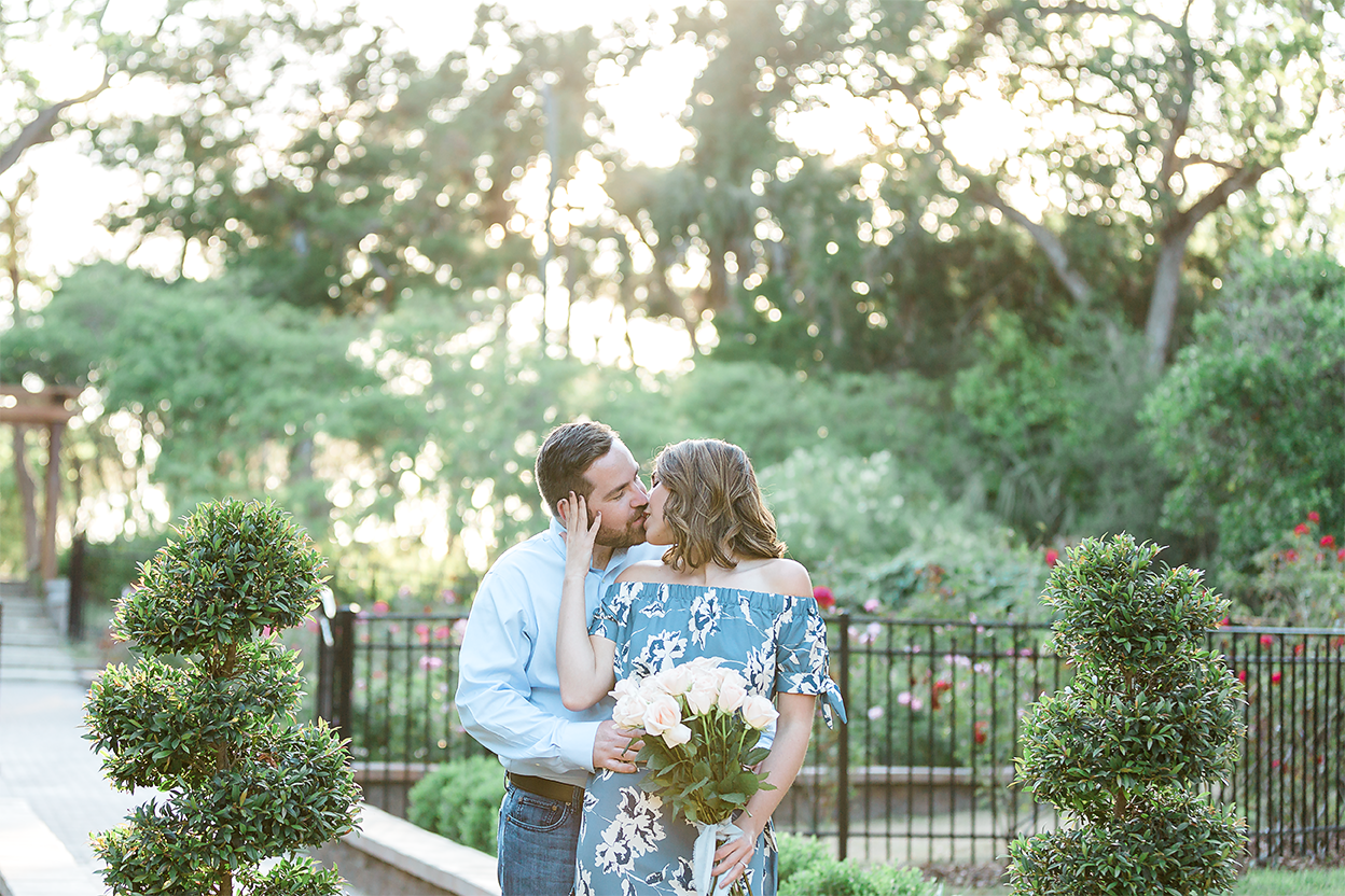 engagement photos in the rose garden in washington oaks