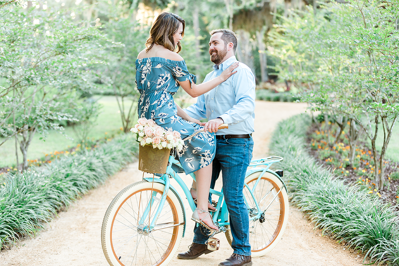 engagement pictures with beach cruiser bike and roses