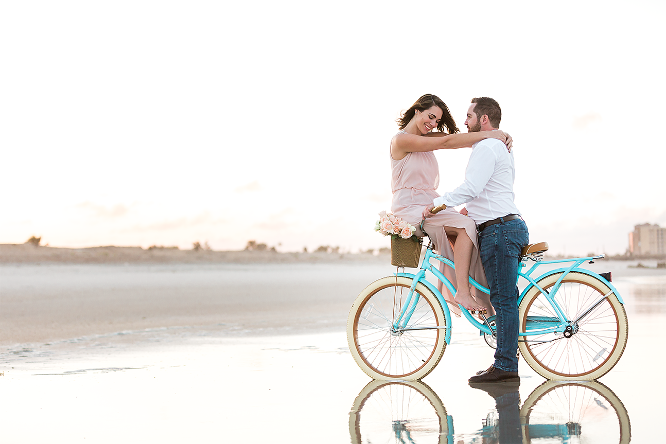 beach cruiser bike engagement pictures during sunset