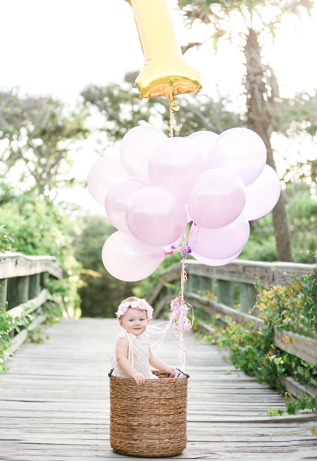 first birthday pictures with balloons and basket