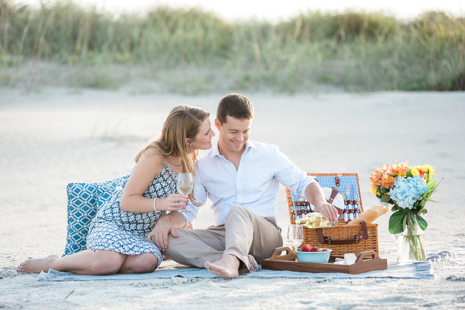 picnic at the beach with engaged couple