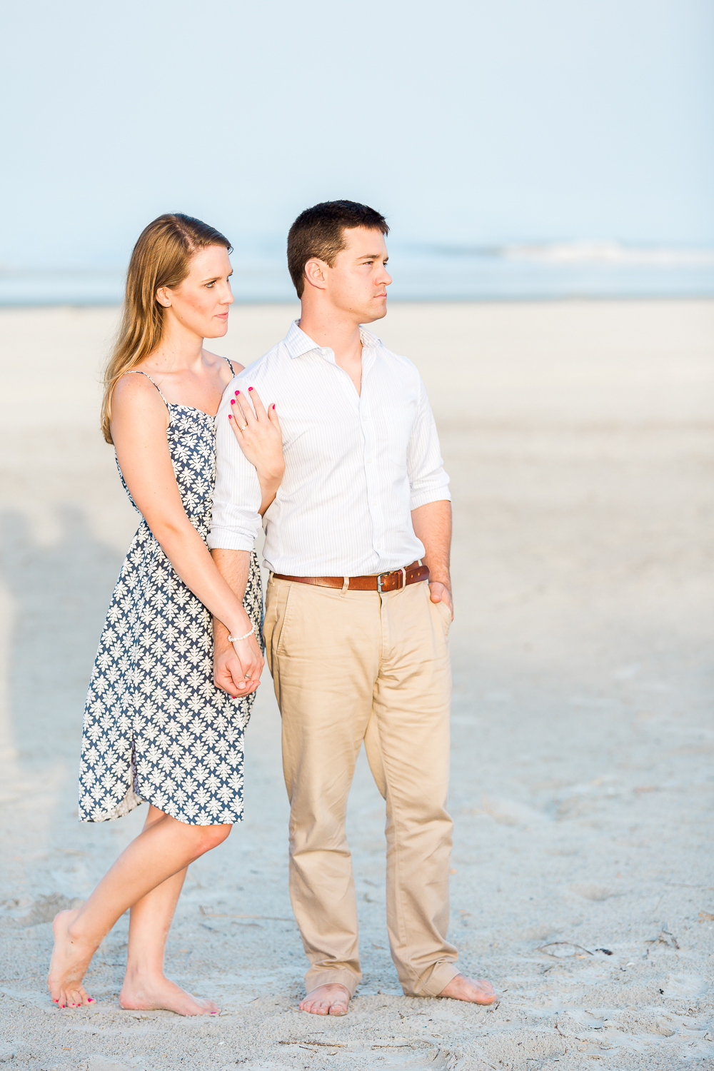 engaged couple at the ebach during sunset