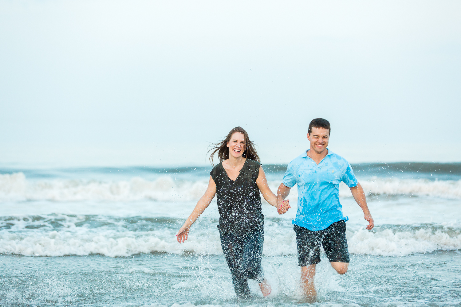 running into the ocean during engagement session