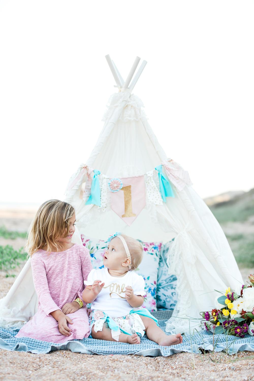siblings in a teepee tent