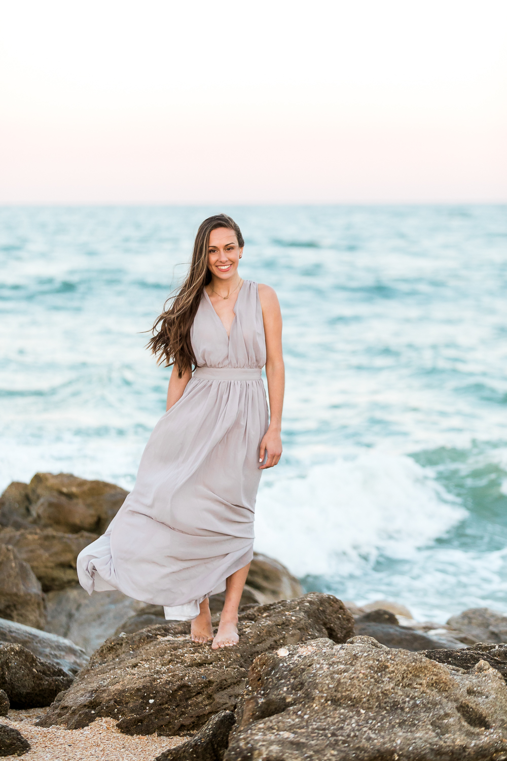 Picture and posing ideas for seniors at the beach during sunset