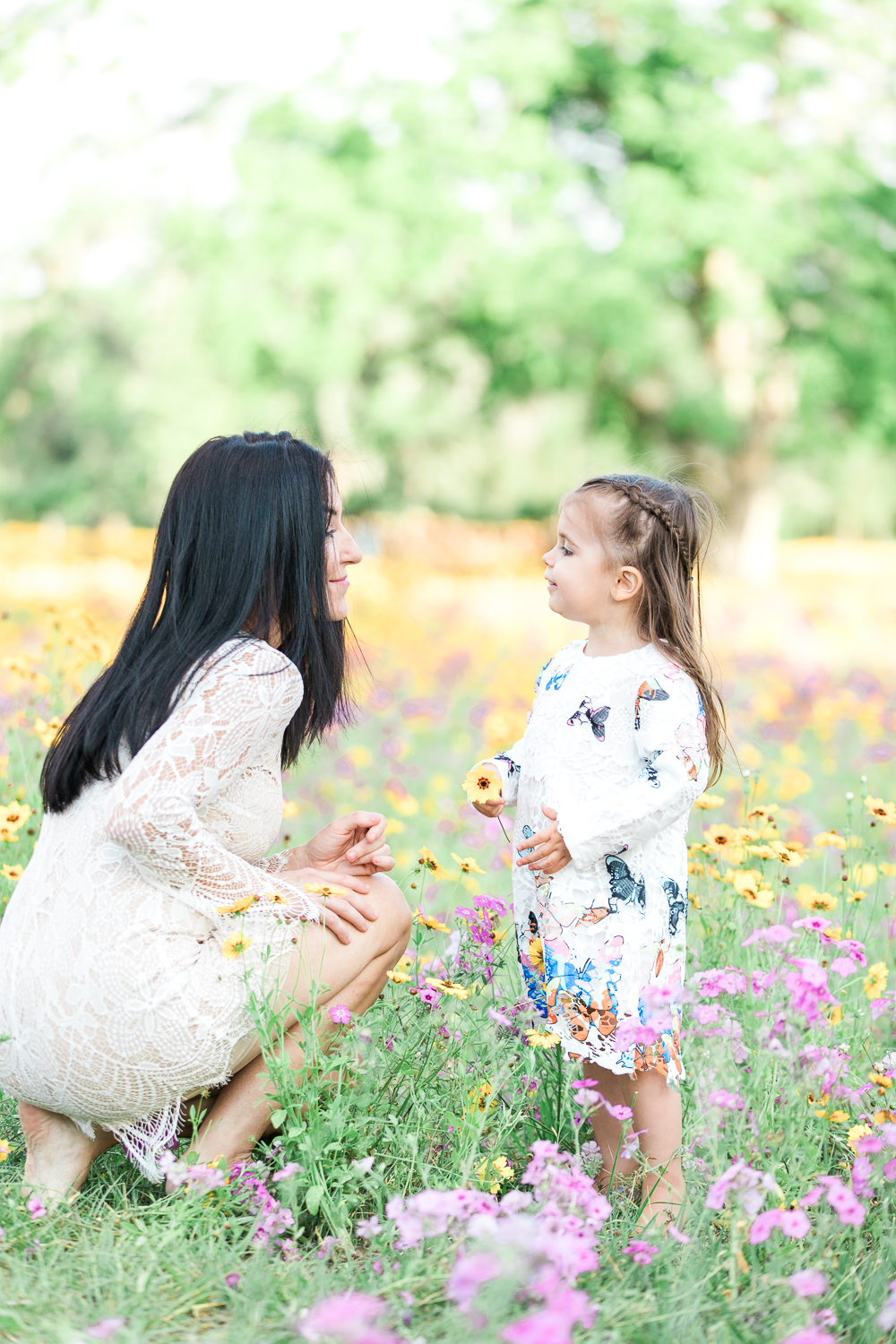 mommy and me photos in a flower field